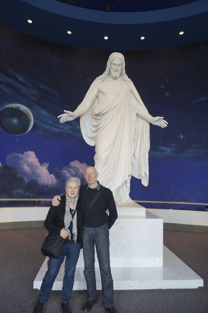 Someone takes a photo of us in front of Jesus