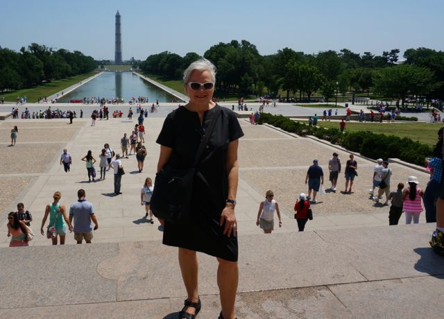 On the steps of the Lincoln Memorial, the Reflecting Pool and Washington Monument obelisk in the background