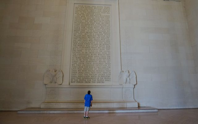 A child reading the Gettysburg Address