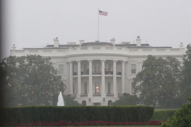 The back of the White House in the pouring rain.