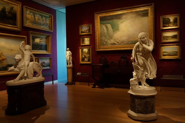 Romanticism in the Museum of Fine Arts, with a painting of Niagara Falls in the background (not by Edwin Chruch)